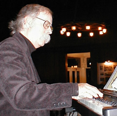 Photo of pianist Dick Bay in action